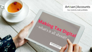 """a woman's hands scrolling a tablet which says """"making tax digital - what's it all about?"""""""